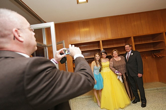 Assistant Principal Steve Fisk takes a photograph of Dave Snyder and his wife Barbara Kolbet Snyder, right, with current seniors Jackie Bradley and Desiree Johnson. - YOUNG KWAK