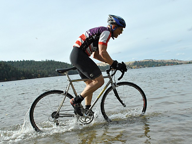 A rider dukes it out with the Liberty Lake course last month. - CHRIS STEIN
