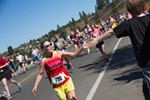 A runner gets a high five on the way up Doomsday Hill.