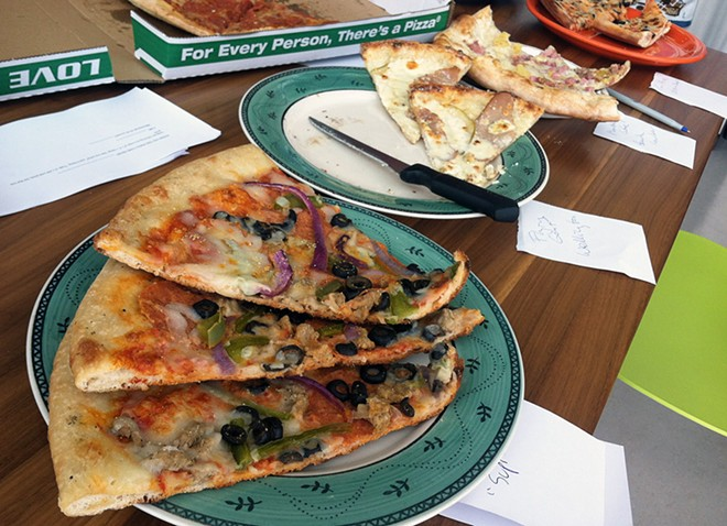A scene from our pizza taste test, in which we tried various types cold and reheated.