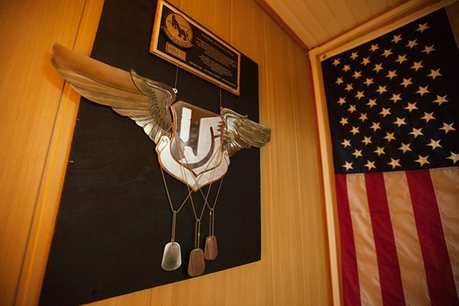 "A ""Shell 77"" memorial is photographed at the at the 376th Expeditionary Operations Group office, which was a K-135 that crashed in Kyrgyzstan on May 3, 2013. On board were three crew members: Captain  Mark Tyler Voss, Captain Victoria ""Tori"" Ann Pinekney and Technical Sergeant Herman ""Tre"" Mackey III. Their home unit was the 92nd Air Refueling Squadron, based at Fairchild Air Force Base. - YOUNG KWAK"