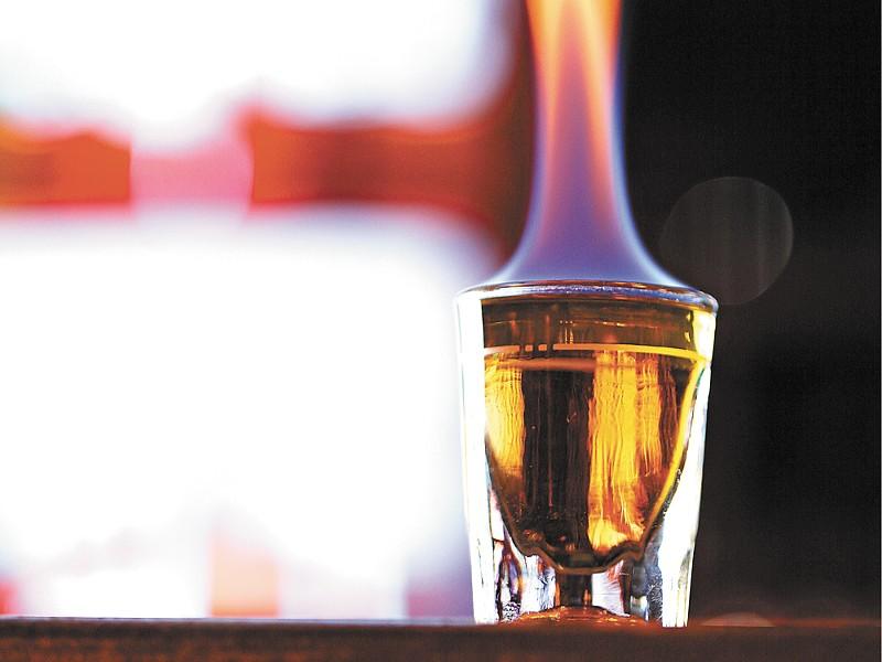 A shot of Fireball lights up the bar top at NYNE. - YOUNG KWAK