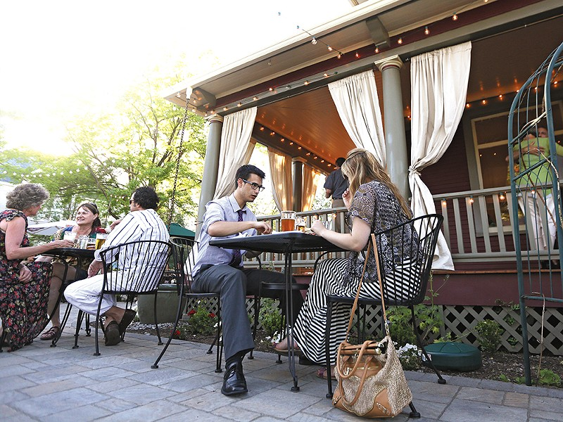 A summer evening on the patio at EJ's Garden Bistro in Browne's Addition. - YOUNG KWAK