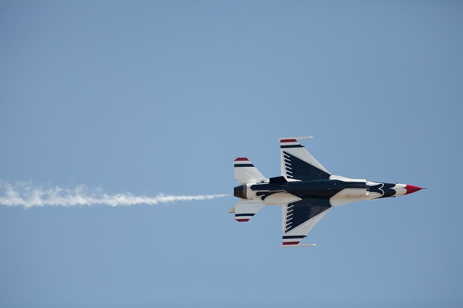 A U.S. Air Force Thunderbirds Air Demonstration Squadron F-16 makes a pass. - YOUNG KWAK