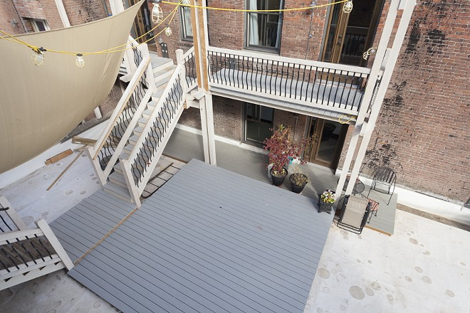 A view of the Laboratory art residency unit's back deck space.