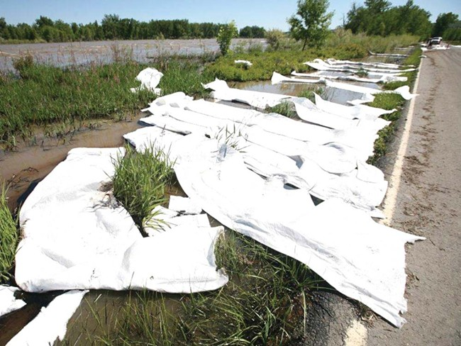 Absorbent pads try to contain the oils in the Yellowstone River. - BILLINGS GAZETTE