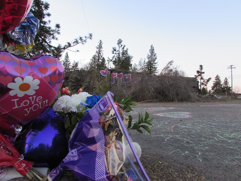 "Across from the memorial site of the accident, the word ""VIRTUE"" has been painted on the rock face in pink and purple — a color dominating much of Meier's artwork. Meier slept in a circle she had drawn and labeled ""virtue"" the night before she was run over by a city truck. - Her family colored in the word ""virtue"" and decorated the surrounding asphalt with sidewalk chalk drawings. - DANIEL WALTERS PHOTO"