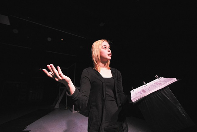 """Actress Anika Bryceson, who plays the lead character """"Fifi,"""" reads from The Clink at Stage Left Theater. - YOUNG KWAK"""