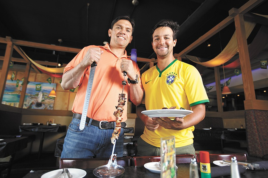 Adriano de Souza (left), owner of Grille from Ipanema, with friend and fellow soccer fan Eduardo Amorim. - YOUNG KWAK