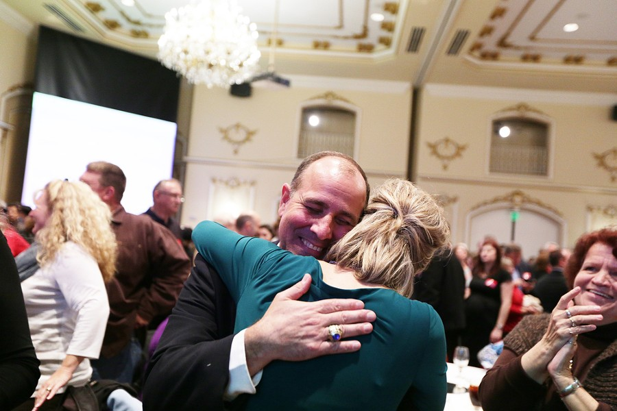 After first election results Spokane County Clerk Timothy Fitzgerald (R), left, hugs Tracy Pendarvis. - YOUNG KWAK