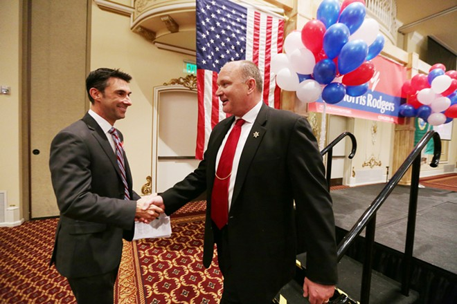 After speaking, Spokane County Sheriff Ozzie Knezovich (R), right, shakes hands with Legislative District 6 State Rep. Kevin Parker (R). - YOUNG KWAK