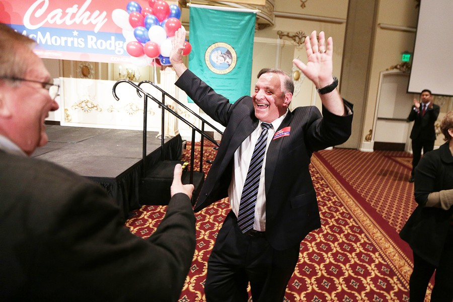 After the first election results show him with a 17 point lead over his rival Breean Beggs (D), not pictured, Spokane County Prosecuting Attorney candidate Larry Haskell (R), right, celebrates with Spokane County Republican Party Chair Dave Moore. - YOUNG KWAK