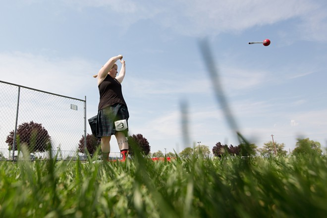 Allison Hawn, from Spokane, Wash., throws a hammer during the women's amateur A & B competition. - YOUNG KWAK
