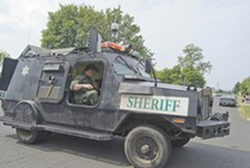 An armored vehicle from the Sheriff's Office arrives at the scene of a tense standoff last August on East Sprague Avenue. - JACOB JONES