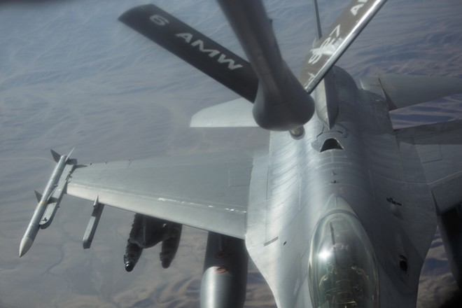An F-16 approaches a 376th Expeditionary Operations Group KC-135 during a refueling mission over Afghanistan. - YOUNG KWAK