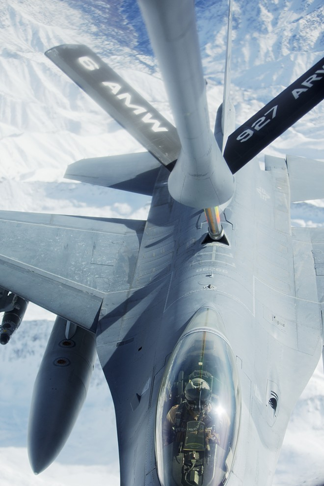 An F-16 is linked to a 376th Expeditionary Operations Group KC-135 during a refueling mission over Afghanistan. - YOUNG KWAK