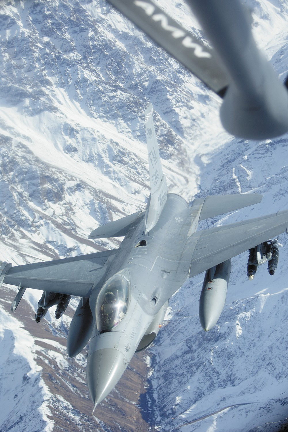 An F-16 soars away after getting fuel from a KC-135 tanker over northern Afghanistan. - YOUNG KWAK