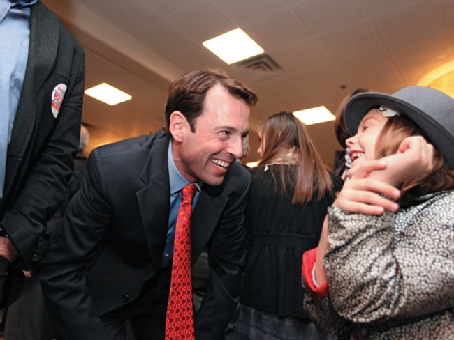 Andy Billig, celebrating his election to the Washington State Senate, courts a future voter at an election night party at Spokane's Red Lion hotel. - YOUNG KWAK