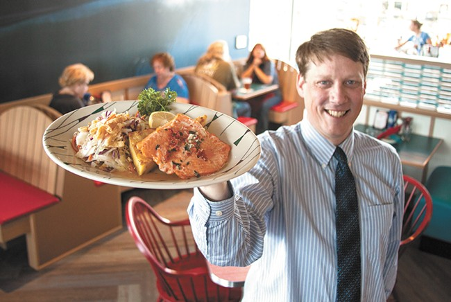 Anthony's Beach Cafe General Manager Andrew Miller shows off cuisine at the newly opened South Hill seafood spot. - ASHLEY TOMLINSON
