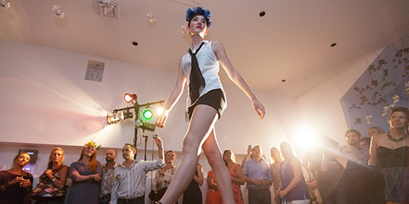 PHOTOS: Olive + Boone Custom Millinery Show Ariel St. Clair walks the runway. Young Kwak
