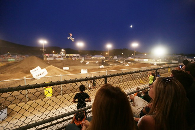 Ashley Wiedenhoff, right, watches Metal Mulisha freestyle rider Jimmy Hill perform. - YOUNG KWAK