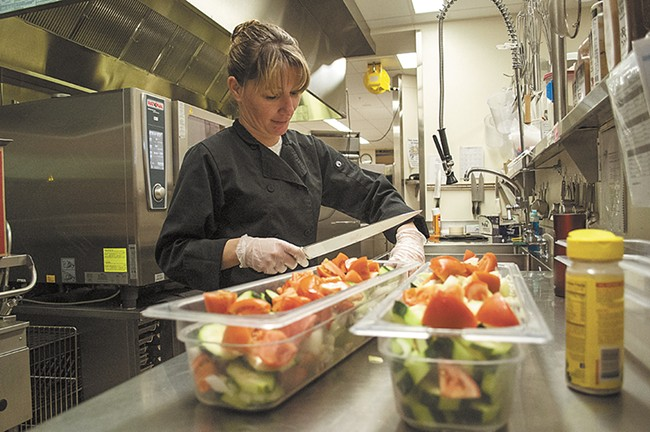 Assistant cook Rene Mahaffy crafts a brightly colored, fresh salad.