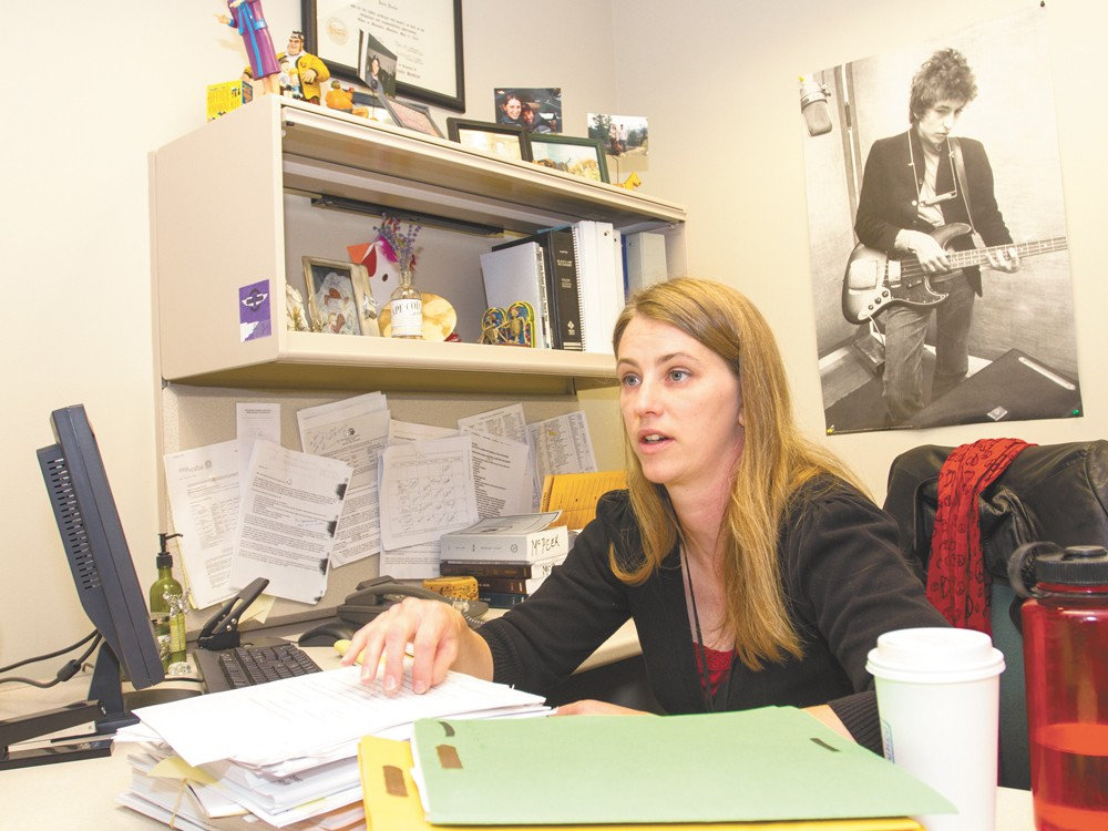 Assistant Public Defender Alison McPeek and a few of her many cases. - JEFF FERGUSON
