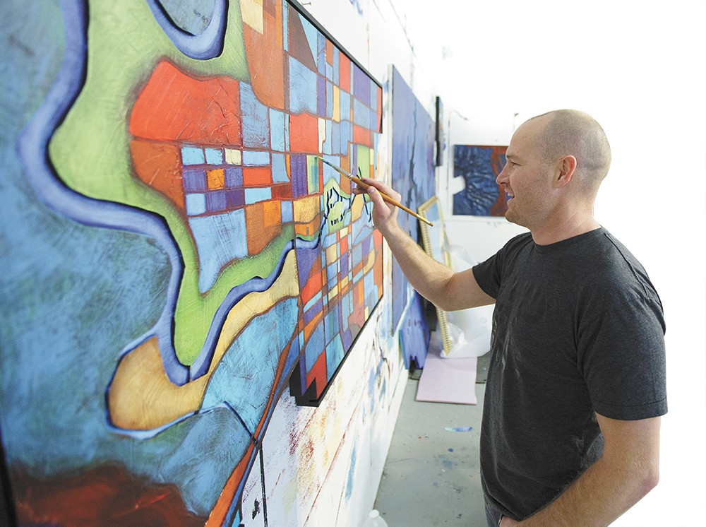 "At his studio, Ben Joyce paints ""Spokane"" for Windermere City Group. - YOUNG KWAK"