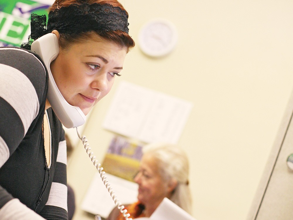 At Mary Verner's re-election headquarters, office manager Diane Rice, Verner's daughter, makes a phone call. - YOUNG KWAK
