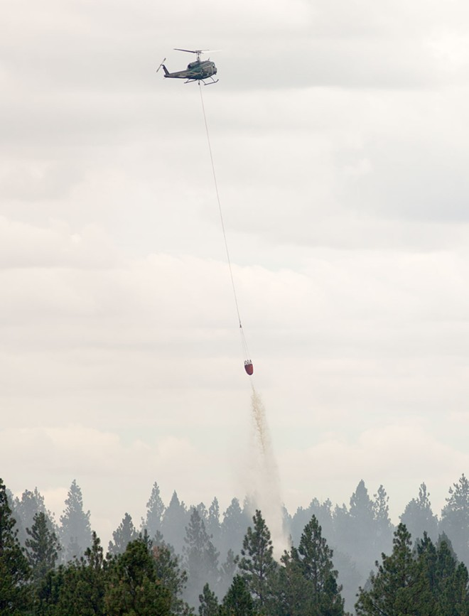 The scene yesterday near the Watermelon Hill fire, which is still burning about 7 miles southwest of Cheney. - YOUNG KWAK
