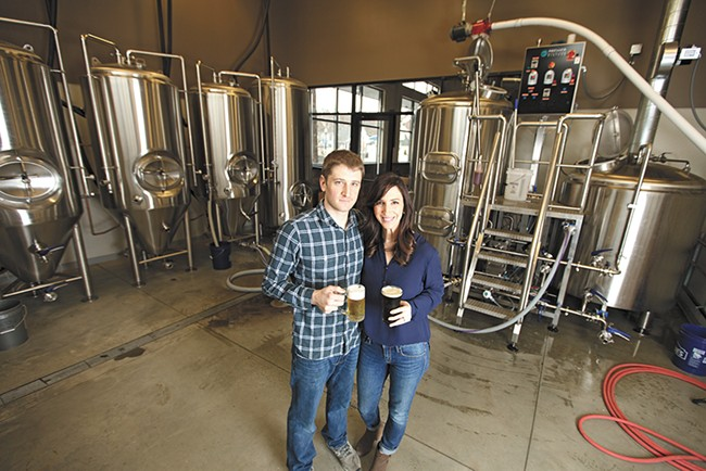 Ben and Christy Lukes in the new Perry Street Brewing facility. - YOUNG KWAK