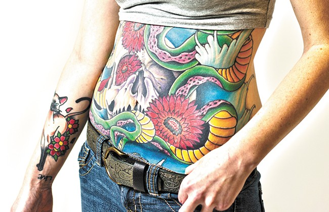 Beth Hill's belly tattoo has required 25 hours in the artist's chair, and there's still work to be done. - YOUNG KWAK