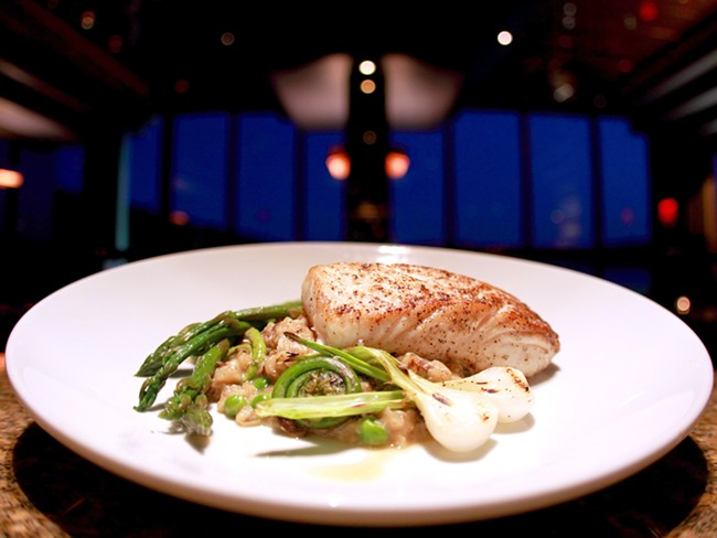 Beverly\'s fresh halibut is served with zesty spring risotto. - JOE KONEK