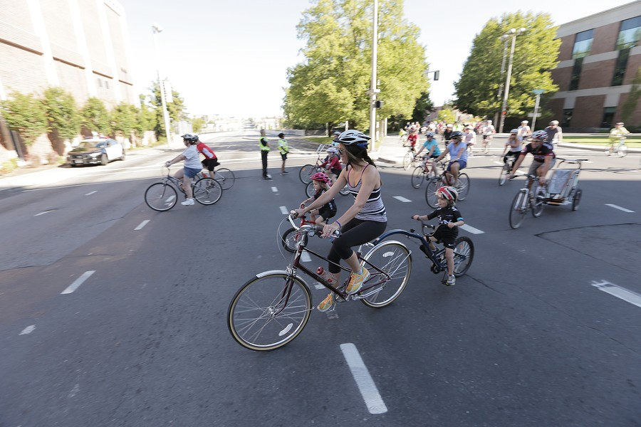 Bicyclists start the REI 21 Mile River Loop and Spokane Falls Loop routes. - YOUNG KWAK