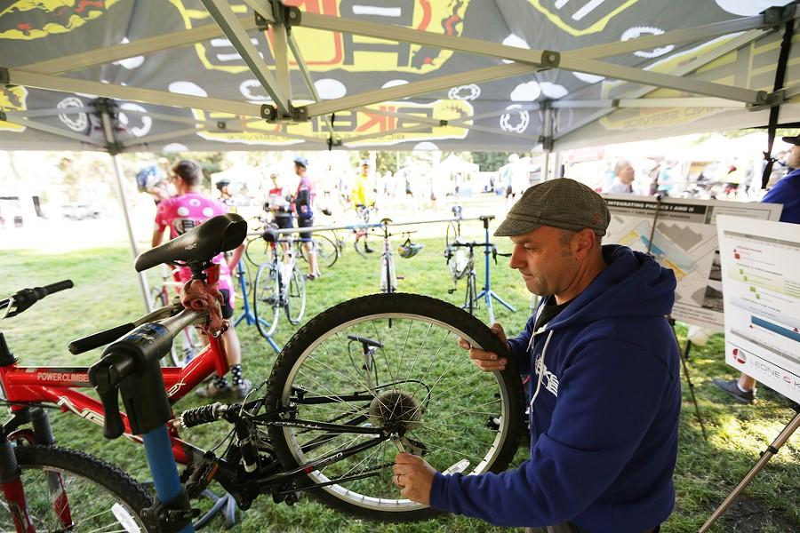 Bike Hub Co-Owner John Abernathy finishes a tube repair on a bicycle, - YOUNG KWAK