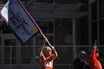 Bill Iffrig waves the Bloomsday flag at the start of the race.