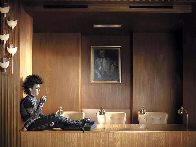 Boardroom punk (he's the one on the wall)