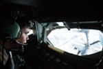 Boom Operator Senior Airman Dave Fernandez, of the 376th Expeditionary Operations Group, refuels an F-16 from a KC-135 over northern Afghanistan on Dec. 14. Fernandez's home unit is based at Fairchild Air Force Base.