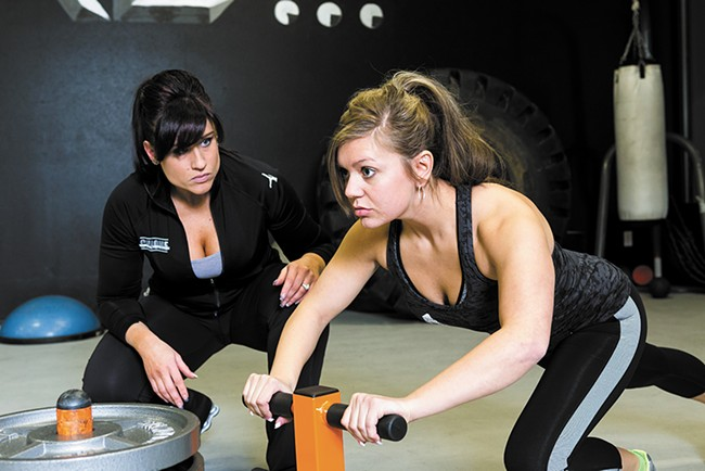 Brenna Grover trains under the watchful eye of Brooke Holloman at Chrome Personal Fitness. - STEPHEN SCHLANGE
