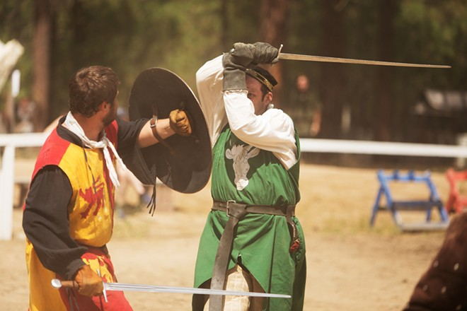 Brian Thornton (Sir Guy Du Malvier). right, and Tieg Thornton (Sir Jude Llewellyn) fight during Knightly Games on Foot. - YOUNG KWAK