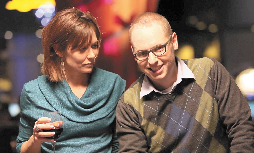 Brooke Stocker and Mark Robbins play a sarcastic-wife-and-doofus-husband duo.