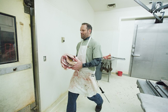 Tim Branen carries pork belly to be smoked into bacon. - YOUNG KWAK
