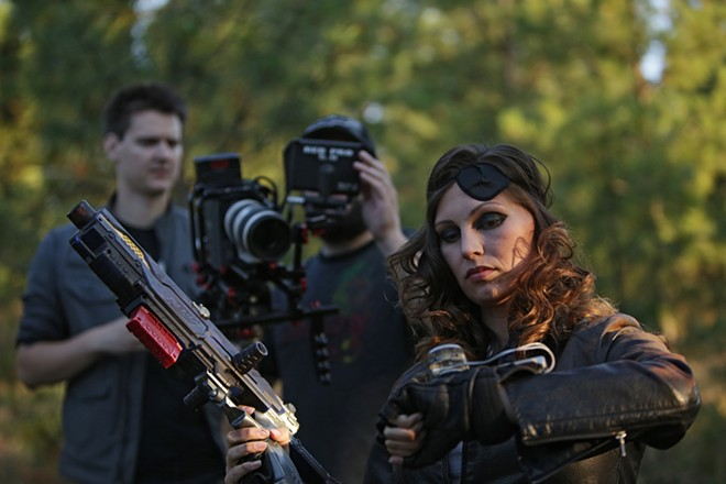 During filming of an episode of Transolar Galactica on Aug. 3, camera operator Shaun Springer, center, shoots an insert shot of Regina (Crystal Pointek), right, as director Adam Harum looks on. - YOUNG KWAK