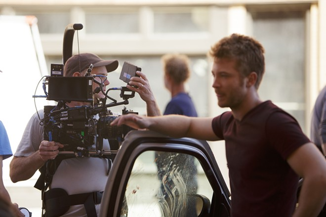 Camera Operator Stephen McGehee, left, prepares for a scene as Mack (Michael Welch) waits. - YOUNG KWAK
