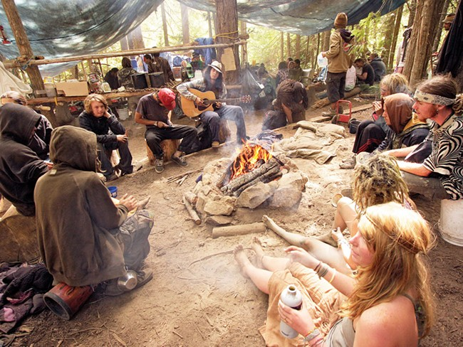 Campers listen to music at the Montana Mud camp, during the Rainbow People gathering in the Colville National Forest. - YOUNG KWAK
