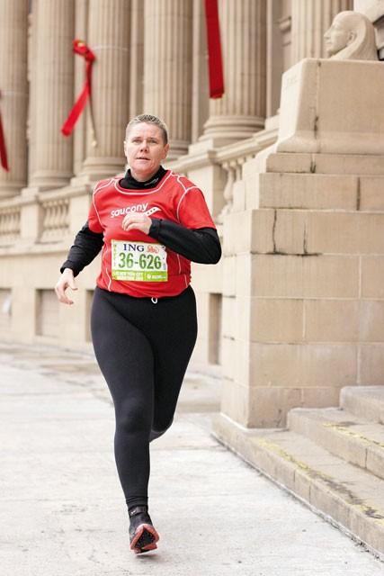 Cancer survivor Carol Dellinger has run three marathons this year. - YOUNG KWAK