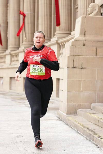 Cancer survivor Carol Dellinger has run three marathons this year. - YOUNG KWAK