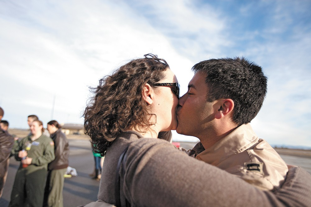 Capt. Ariel Kayne kisses his wife, Sara, for the first time in three months, at Fairchild Air Force Base. - YOUNG KWAK