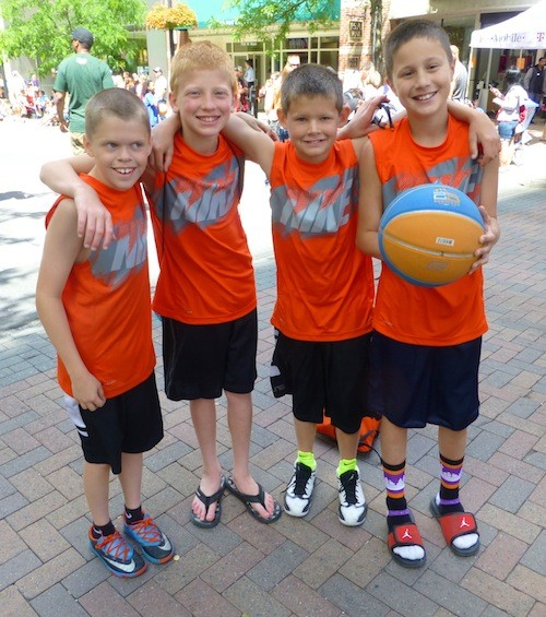 Carson Lehnert, Cole Thomas, Jaxon Kourtlever and Avery Donner traveled to Spokane from Blaine, Wash., for Hoopfest weekend. This bright orange brigade of boys had a blast while wearing matching Nike tops.  Donner even wore Strideline socks. - MADISON BENNETT