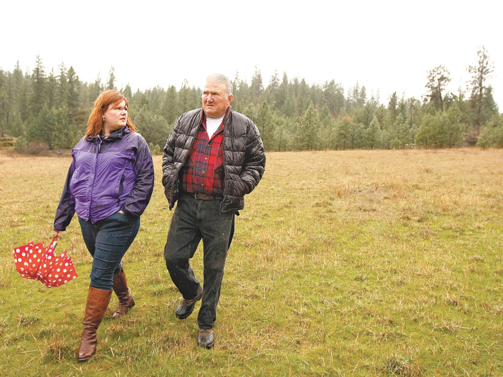 Cassie Price, left, and her father, Ross Taylor, walk their family property in Spokane Valley. - YOUNG KWAK